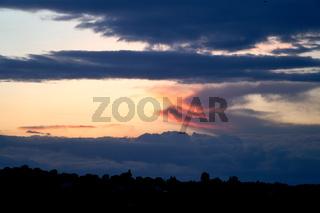 Fiery orange and blue sunset sky. Beautiful sky. Background nature. Life