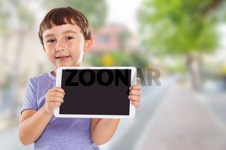 Young boy child holding tablet computer town copyspace copy space information marketing ad advertising