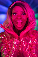 Wow facial expression of young sexy woman. Ecstatic or surprised African American woman with open mouth and open palms in bright neon lights. Emotions concept. Vogue concept