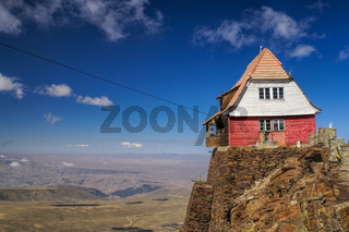 Wooden hut on the edge of cliff on mountain Chacaltaya in south american Andes