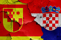 flags of Krapina-Zagorje County and Croatia painted on cracked wall