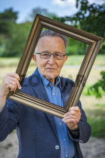 Pensioner in a picture frame