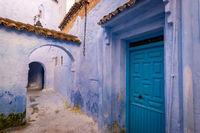 Blue door and alleyway in Chefchaouen, Morocco