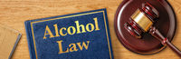 A gavel with a law book - Alcohol Law