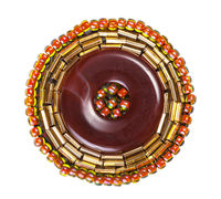 leather brooch decorated by glass beads and bugles