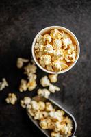 Sweet tasty popcorn in cup.