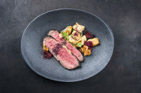 Modern style Commonwealth Sunday roast with sliced cold cuts roast beef