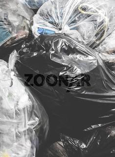Piles of garbage in plastic bin bags