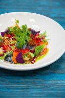 Escabeche fish dish with caviar: