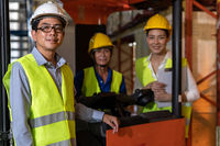 Asian Warehouse manager and team portrait