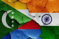 flags of Comoros and India painted on cracked wall