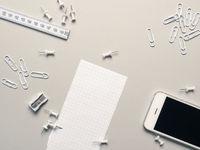 White office utensils on grey