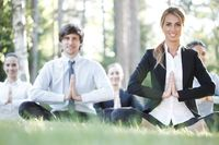 Business team practicing yoga