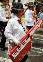 CUENCA, ECUADOR - 2-12-2015: People celebrate in the annual Carnaval parade through the streets of Cuenca Ecuador