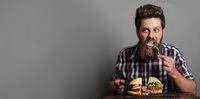 Man eatin large hamburger