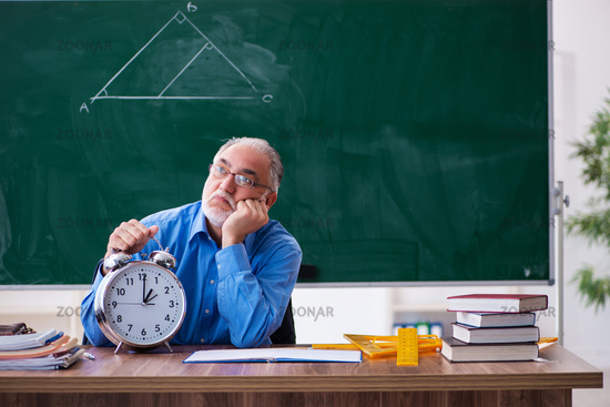Old male math teacher in time management concept