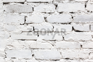 white brick wall background with large seams and plaster