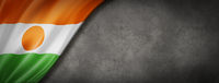 Niger flag on concrete wall banner