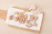 Yeast cubes and flour for bread making on beige background.