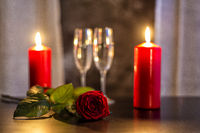 red rose, champagne glasses and candles on Valentine's day