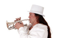 A trumpet player standing in a white outfit and cylinder in close up