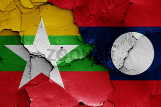 flags of Myanmar and Laos painted on cracked wall