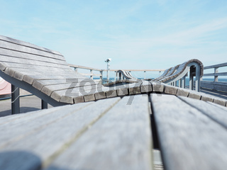 Deckchairs on a pier, selective focus on foreground, vacation or travel concept