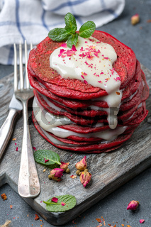 Red velvet pancakes served with cream cheese sauce.