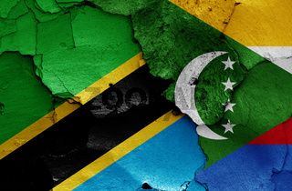 flags of Tanzania and Comoros painted on cracked wall