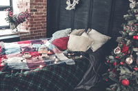 Cozy bed with cups of coffee and wrapped gift box
