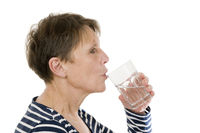 Mature woman drink water