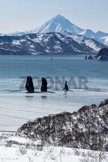 Three Brothers Rocks in Avachinskaya Bay and Vilyuchinsky Volcano (Kamchatka Peninsula)
