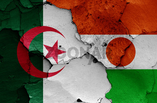 flags of Algeria and Niger painted on cracked wall