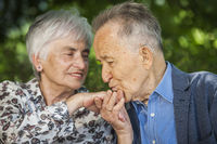 Pensioner kisses his wifes hand