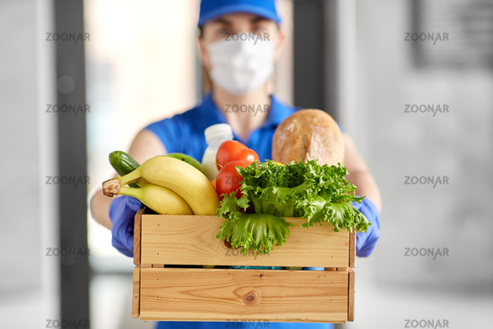 delivery woman in face mask with food in box