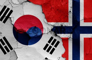 flags of South Korea and Norway painted on cracked wall