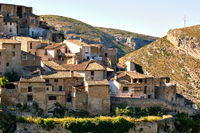 During sunny warm day view to the old obsolete rural houses of Bocairent hillside village placed in north west of Mariola mountain. Vall d'Albaida in Valencian Community, Espana, Spain