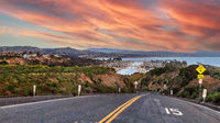 Sunset over Road leading down to Dana Point Harbor