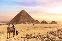 The Pyramid of Menkaure and tourists on camels, Giza, Egypt