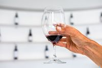 a red wine glass, white tasting room