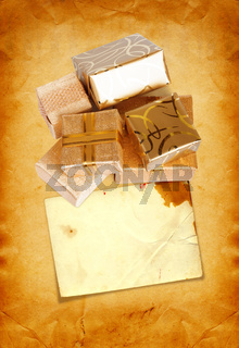 Gift box in gold wrapping paper on vintage cardboard background