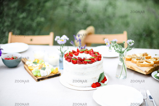 Cake on banquet table in garden