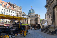 coachmen with horse and carriage wait for tourists at the Frauenkirche Church in Dresden