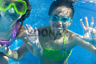 Girls in scuba masks under water