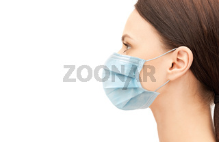 profile of young woman wearing medical mask