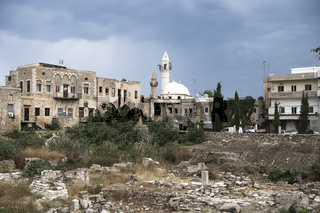 Old city with mosque and ruins with dramatic cloudscape in Tyre, Sour, Lebanon