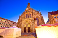 Nurnberg. Church of Our Lady or Frauenkirche in Nuremberg main square dusk view