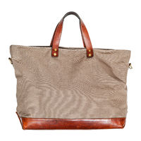 handcrafted handbag made of leather and canvas