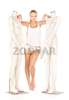 woman in cotton undrewear with mannequins