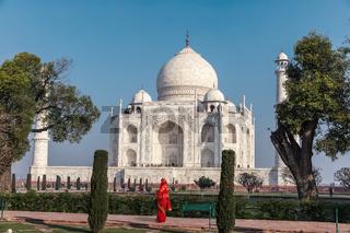 Indian lady in red sari in Taj Mahal, India, Agra
